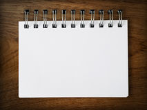 Note on wood wall. Blank Note paper on Wood background Stock Photography