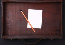 Note in a wooden case Royalty Free Stock Images