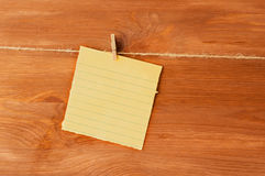 A note on the wooden clothespins on background Stock Photography