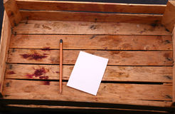 Note in a wooden crate Stock Images