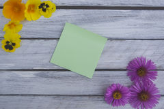 A note on a wooden surface framed by summer flowers 2 Stock Photos