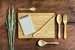 Note and wooden utensil on old wood Stock Images