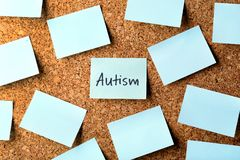 Note with word AUTISM. On cork background Royalty Free Stock Photo
