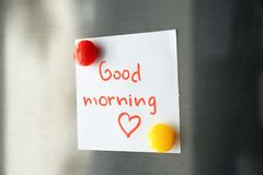 Note with words `Good morning`. On refrigerator door royalty free stock photos