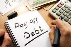 Note with words pay off debt. Note with words pay off debt concept Royalty Free Stock Photo