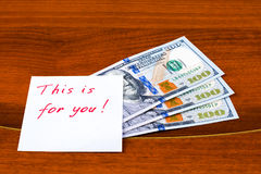 Note `This is for you` and $ 300. On the polished table Stock Photo