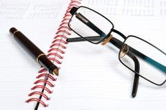Notebbok and pen Stock Photos