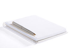 Notebok with pen. Isolated open notebok with metal pen on a white background Royalty Free Stock Photography
