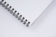 Notebook. In the grey background Royalty Free Stock Photo