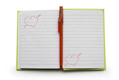 Notebook. Record book with a pen in the middle isolated on a white background Stock Photography