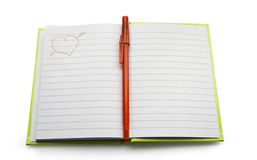 Notebook. Record book with a pen in the middle isolated on a white background Stock Photo
