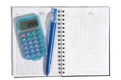 Notebook. Notebook, calculator and pan Stock Photos