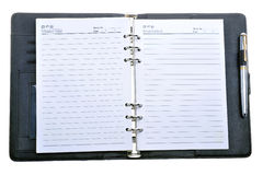 Notebook. A blank notebook and a pen on a white background Stock Photography