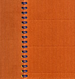 Notebook. Rust-colored corrugated notebook with blue rings Royalty Free Stock Photo