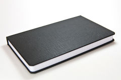 Notebook. Black notebook with blank cover Royalty Free Stock Photos
