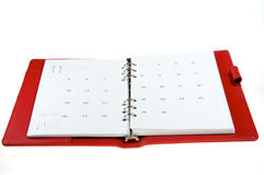 Notebook. Rad leather notebook on a white background Royalty Free Stock Photo