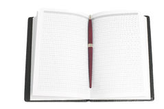Notebook. A notebook and pen,  isolated on white Royalty Free Stock Photo