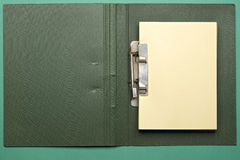 Notebook. Green notebook with yellow pages on green Stock Image