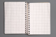 Notebook. Open checked notebook isolated over grey background Royalty Free Stock Photography