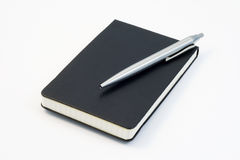 Notebook_3. Closed notebook and a pencil Royalty Free Stock Photo