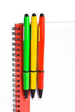 Notebook and 3 colored  pens Royalty Free Stock Photo