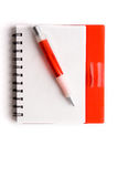 Notebook. Red notebook and ball point pen over white background Royalty Free Stock Photos