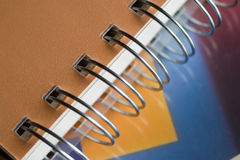 Notebook. Close up on the metallic curtains ring of colouristic notebook Stock Photography