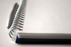 Notebook. Note pad & pen - shallow focus Royalty Free Stock Photos