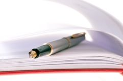 Notebook. With  pen close-up Stock Photo