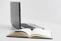 Notebook. Book and laptop, today and futurity Royalty Free Stock Photos