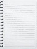 Notebook. At the white background Stock Photos