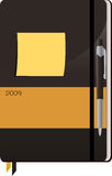 Notebook. Pen And Sticky Note Resting On Top Of A Brown And Orange 2009 Notebook royalty free illustration