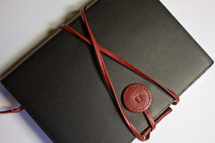 Notebook. A black leather notebook against a white background Royalty Free Stock Image