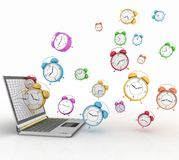 Notebook and alarm clocks Royalty Free Stock Images