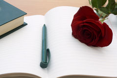 Notebook And Rose Stock Photography