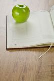 Notebook with apple Stock Photo