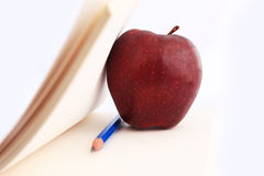 Notebook and Apple. Royalty Free Stock Photos