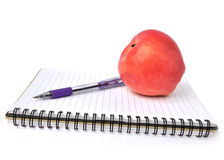 Notebook and apple  Royalty Free Stock Photo