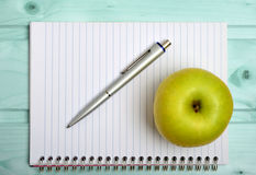 Notebook with apple fruit Royalty Free Stock Image