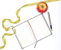 Notebook and apple Royalty Free Stock Image