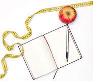 Notebook and apple Stock Photo