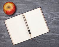 Notebook and apple Royalty Free Stock Photos