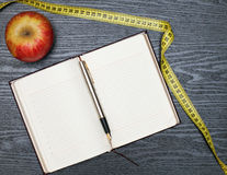 Notebook and apple Royalty Free Stock Photography