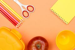 Notebook, apple, scissors, color pencils, plastic cup and lunch box. School supplies. School supplies. Notebook, apple, scissors, color pencils, plastic cup and royalty free stock photos
