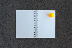 Notebook on asphalt texture background Royalty Free Stock Photo