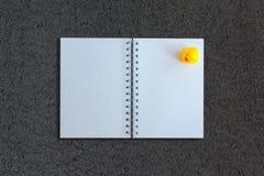 Notebook on asphalt texture background Royalty Free Stock Photo