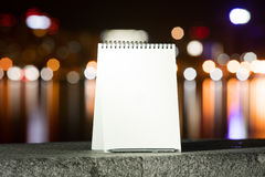 Notebook on the background of the city at night Stock Photography