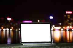 Notebook on the background of the city at night Royalty Free Stock Photography