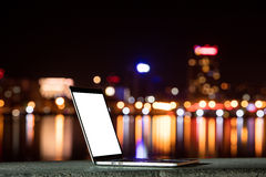 Notebook on the background of the city at night Stock Photos