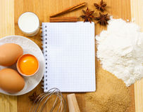 Notebook for baking recipes. Notebook for recipes with raw baking ingredients royalty free stock photos